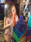 Eliza loved her magna-tiles.